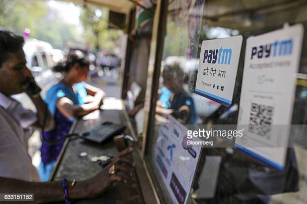 Signage for digitalpayments provider Paytm operated by One97 Communications Ltd is displayed at a telephone booth in the Parel area of Mumbai India...