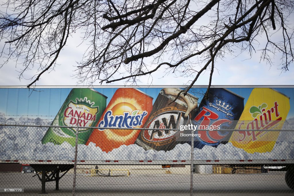Signage for Dr. Pepper Snapple Group Inc. brand soda is seen on a delivery truck outside a facility in Louisville, Kentucky, U.S., on Tuesday, Feb. 13, 2018. Dr. Pepper Snapple Group Inc. is scheduled to release earnings figures on February 14. Photographer: Luke Sharrett/Bloomberg via Getty Images