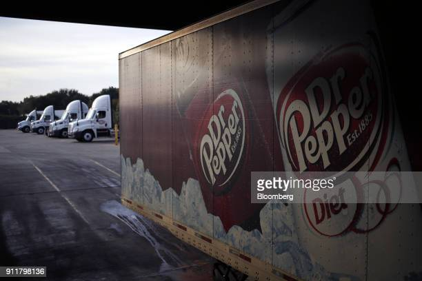 Signage for Dr Pepper soda is displayed on a delivery truck outside the Dr Pepper Snapple Group Inc bottling plant in Irving Texas US on Tuesday Oct...