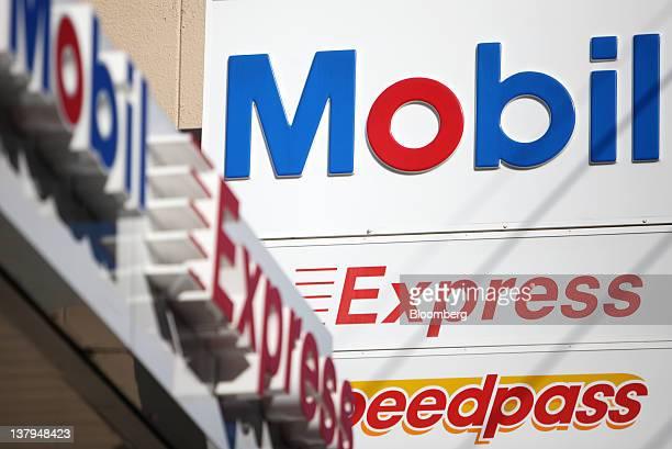 Signage for Exxon Mobil Yugen Kaisha's Mobil gas station is displayed in Tokyo Japan on Monday Jan 30 2012 TonenGeneral Sekiyu KK agreed to buy...