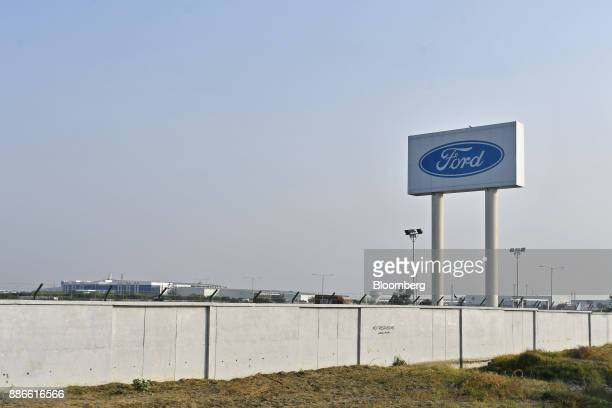 Signage for Ford Motor Co stands at the automaker's Sanand Vehicle Assembly and Engine Plant in Sanand Gujarat India on Wednesday Nov 22 2017 The...