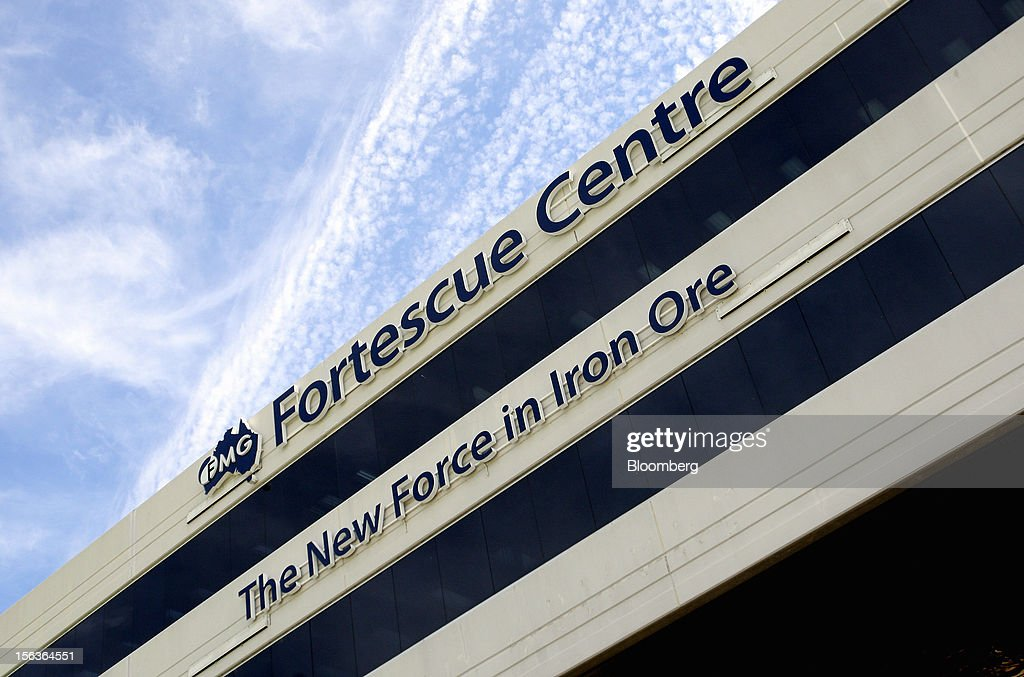 Signage for Fortescue Metals Group Ltd. is displayed atop the company's headquarters in Perth, Australia, on Wednesday, Nov. 14, 2012. Andrew Forrest, founder of Fortescue Metals, last month defeated a regulator's claim that he misled shareholders of the iron-ore exporter which made him Australia's fourth-richest person. Photographer: Sergio Dionisio/Bloomberg via Getty Images