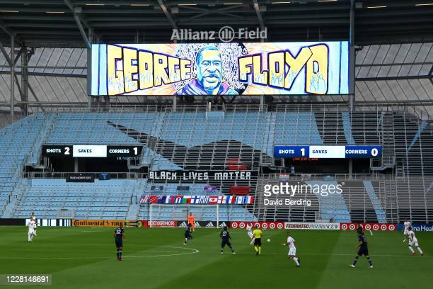 Signage for George Floyd and Black Lives Matter is displayed in the first half during the game between Sporting Kansas City and Minnesota United at...