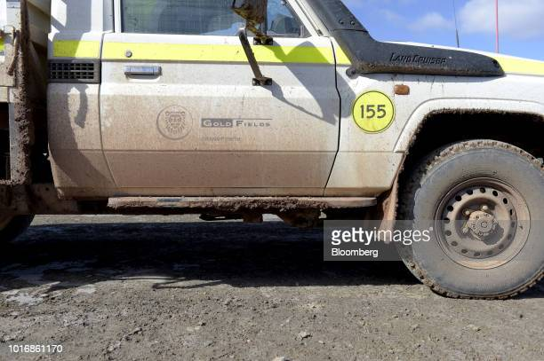 Signage for Gold Fields Ltd is displayed on the door of a vehicle at the Granny Smith gold mine outside of Laverton Western Australia Australia on...