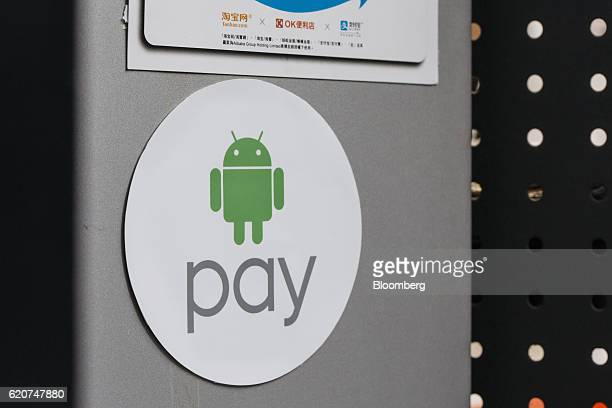 Signage for Google Inc's Android Pay is displayed outside a store in Hong Kong China on Tuesday Nov 1 2016 The urgency to prepare regulatory...