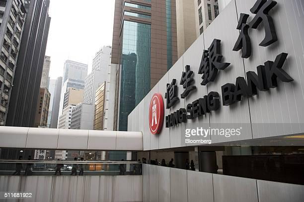Signage for Hang Seng Bank Ltd is displayed outside the bank's headquarters in Hong Kong China on Monday Feb 22 2016 Shares of Hang Seng Bank the...