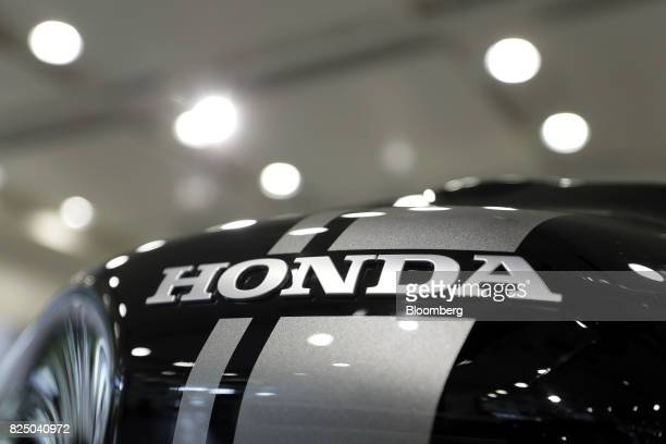Signage for Honda Motor Co is displayed on a CB1100 RS motorcycle at the company's showroom in Tokyo Japan on Tuesday Aug 1 2017 Honda is scheduled...