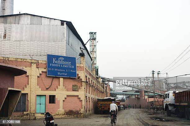 Signage for Kohinoor Foods Ltd is displayed on the outside wall of a rice mill in Karnal Haryana India on Thursday May 19 2016 A good monsoon season...