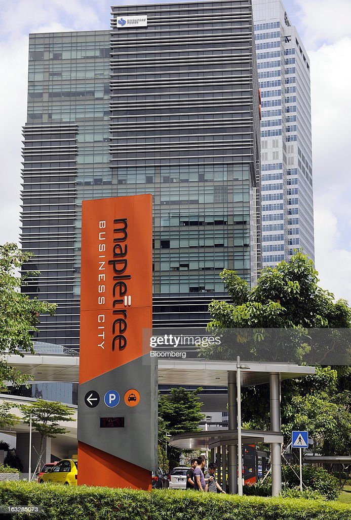Signage for Mapletree Business City, operated by Mapletree Investments Pte, stands outside an office building in Singapore, on Thursday, March 7, 2013. Mapletree Greater China Commercial Trust, Asia's biggest share sale this year, gained on its first trading day as investors were attracted by returns higher than those of comparable properties. Photographer: Munshi Ahmed/Bloomberg via Getty Images
