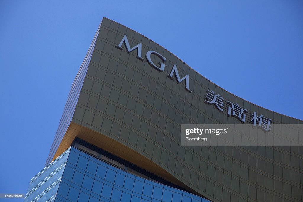 Signage for MGM Macau, operated by MGM China Holdings Ltd., is displayed atop of the casino resort in Macau, China, on Sunday, Aug. 4, 2013. MGM China Holdings is scheduled to release second quarter results on Aug. 6. Photographer: Lam Yik Fei/Bloomberg via Getty Images