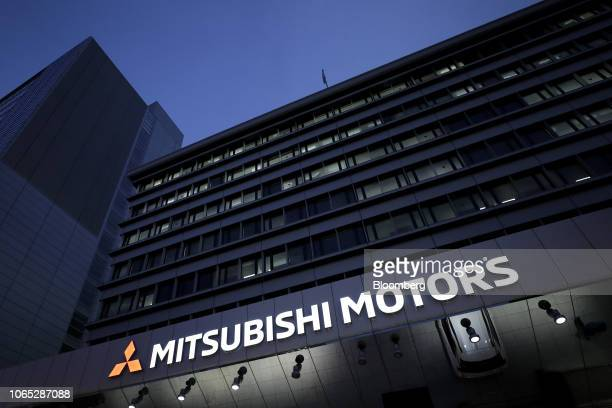 Signage for Mitsubishi Motors Corp. Is illuminated at the company's headquarters in Tokyo, Japan, on Monday, Nov. 26, 2018. Carlos Ghosn was...