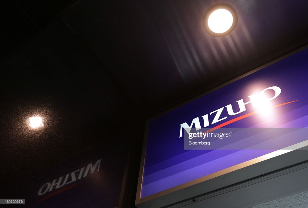 Signage for Mizuho Financial Group Inc. is displayed outside a Mizuho Bank Ltd. branch in Tokyo, Japan, on Thursday, Jan. 29, 2015. Mizuho Financial Group, Japan's third largest bank, is scheduled to report third-quarter earnings on Jan. 30. Photographer: Tomohiro Ohsumi/Bloomberg via Getty Images