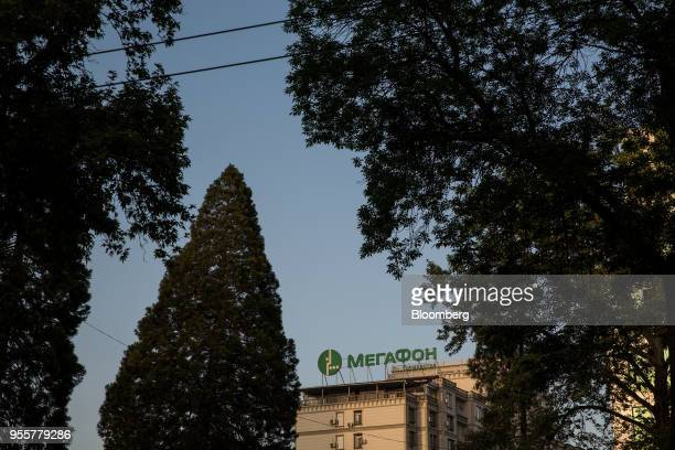 Signage for mobile provider MegaFon PJSC is displayed atop a building in Dushanbe Tajikistan on Sunday April 22 2018 Flung into independence after...