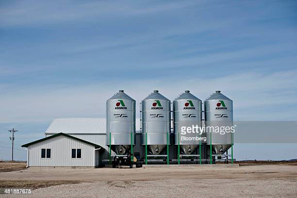 Signage for Monsanto Co Asgrow brand soybeans hangs on the side of storage silos at the Crop Production Services facility in Manlius Illinois US on...