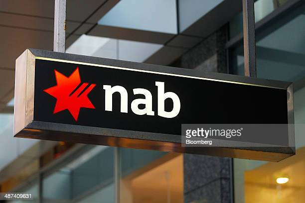 Signage for National Australia Bank Ltd is displayed outside one of the bank's branches in Sydney Australia on Wednesday April 30 2014 National...