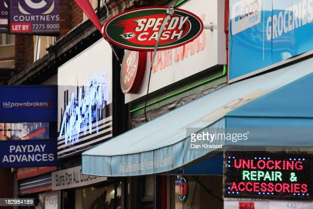 Signage for pawnbroker and payday loan stores on a high street in Dalston on October 3, 2013 in London, England. Payday loan stores are to face...