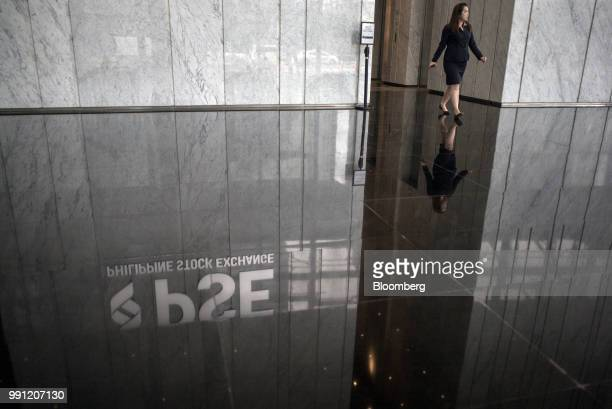 Signage for Philippine Stock Exchange Inc is reflected on the ground in the lobby of the bourse in Bonifacio Global City Metro Manila the Philippines...