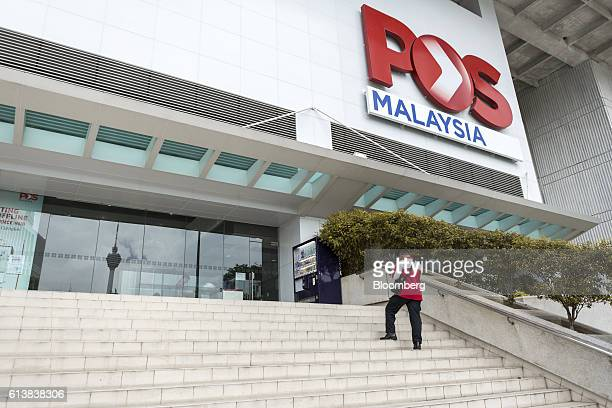 Signage for Pos Malaysia Bhd is displayed outside the company's Dayabumi Complex post office in Kuala Lumpur Malaysia on Tuesday Sept 27 2016...