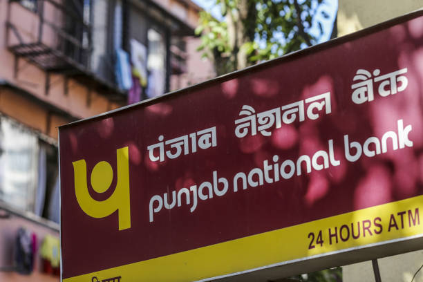 Signage for Punjab National Bank is displayed outside a branch in Mumbai India on Sunday April 22 2018 PNB is scheduled to announce full year...