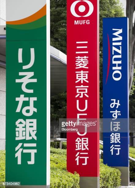 Signage for Resona Bank Ltd from left Bank of TokyoMitsubishi UFJ Ltd and Mizuho Bank Ltd are displayed in Tokyo Japan on Friday Nov 10 2017 Mizuho...