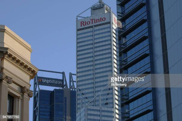 Signage for Rio Tinto Ltd is displayed atop the Central Park Tower center and BHP Billitton Ltd atop the Brookfield Place Tower left in the central...