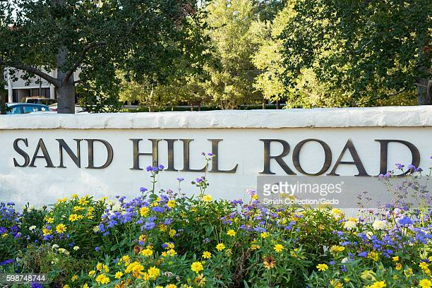Signage for Sand Hill Road with flowers in the Silicon Valley town of Menlo Park California August 25 2016 In Silicon Valley culture Sand Hill Road...