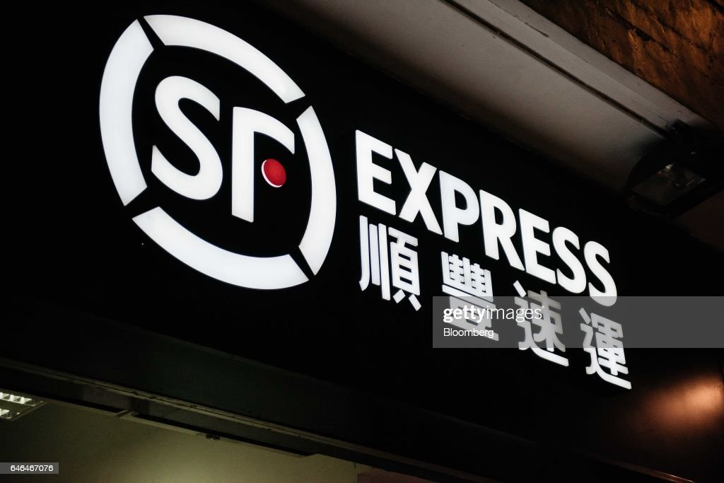 Signage For S F Express Is Displayed Atop One Of The