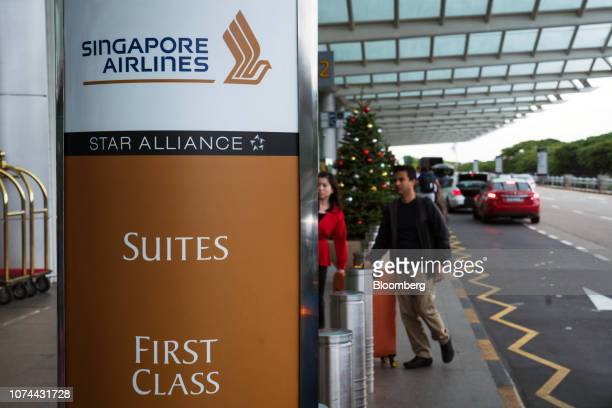 Signage for Singapore Airlines Ltd stands on display at Terminal 2 of Changi Airport in Singapore on Thursday Dec 13 2018 Singapore'sChangiAirport...
