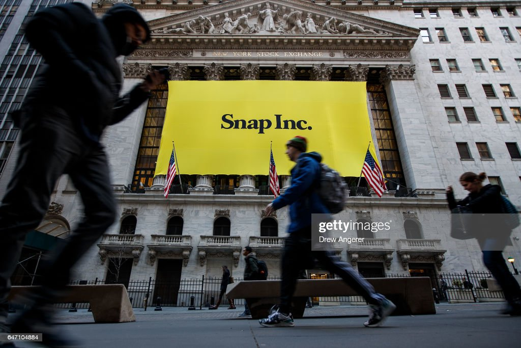 Signage for Snap Inc., parent company of Snapchat, adorns the front of the New York Stock Exchange (NYSE), March 2, 2017 in New York City. Snap Inc. priced its initial public offering at $17 a share on Wednesday and Snap shares will start trading on the New York Stock Exchange (NYSE) on Thursday.