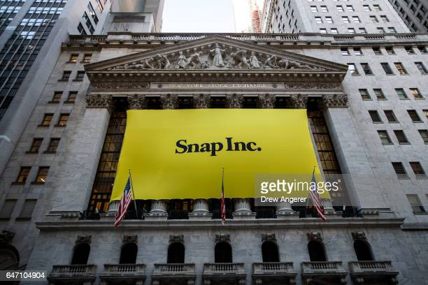 Signage for Snap Inc parent company of Snapchat adorns the front of the New York Stock Exchange March 2 2017 in New York City Snap Inc priced its...