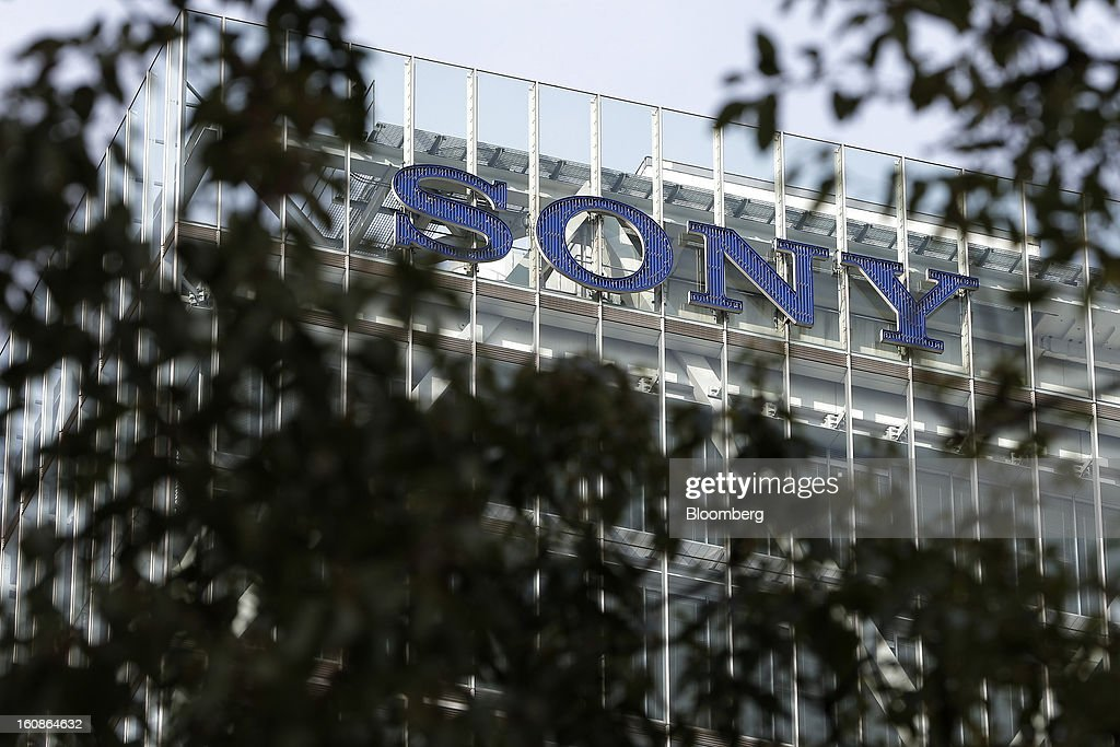 Signage for Sony Corp. is seen through foliage atop the company's headquarters in Tokyo, Japan, on Thursday, Feb. 7, 2013. Sony, Japan's biggest consumer-electronics exporter, reported an eighth consecutive quarterly loss on waning demand for TVs and consumer preferences for devices from Apple Inc. and Samsung Electronics Co. Photographer: Kiyoshi Ota/Bloomberg via Getty Images