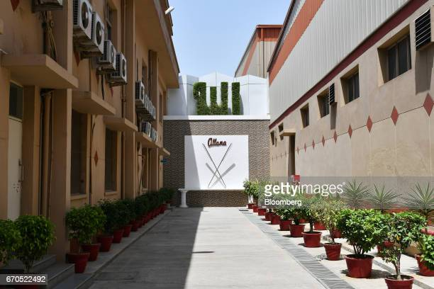 Signage for the Allana Group stands on a wall outside a plant operated by the company in Aligarh Uttar Pradesh India on Tuesday April 11 2017 Allana...