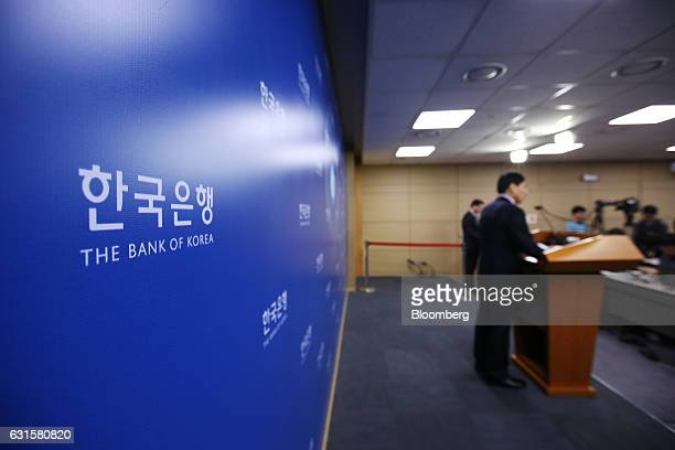 Signage for the Bank of Korea is displayed as Lee Ju Yeol governor of the BOK speaks during a news conference following a monetary policy meeting at...