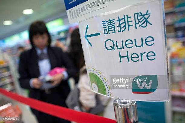 Signage for the cashier's line is displayed in a Watsons store operated by AS Watson Co in the Tsim Sha Tsui district of Hong Kong China on Tuesday...