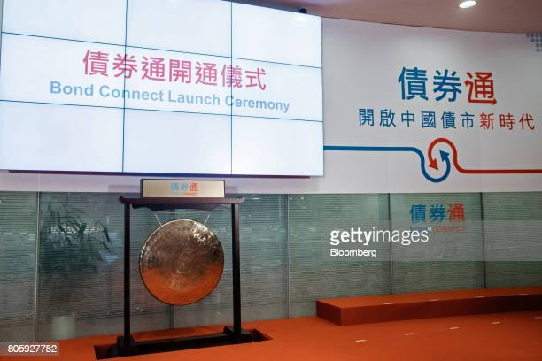 Signage for the ChinaHong Kong Bond Connect and a gong are seen at the Hong Kong Stock Exchange in Hong Kong China on Monday July 3 2017 The first...