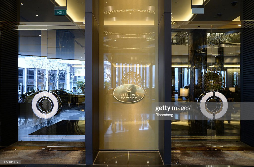 Signage for the Crown Towers hotel, part of the Crown Melbourne casino and entertainment complex operated by Crown Ltd., is displayed at the entrance to the property in Melbourne, Australia, on Wednesday, Aug. 21, 2013. Crown Ltd., the gaming company controlled by billionaire James Packer, is scheduled to announce full-year results on Aug. 23. Photographer: Carla Gottgens/Bloomberg via Getty Images