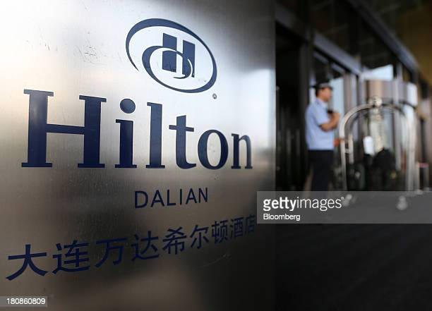 Signage for the Dalian Hilton Hotel operated by Hilton Worldwide Inc is displayed outside the hotel at the Dalian Wanda Center a property owned by...