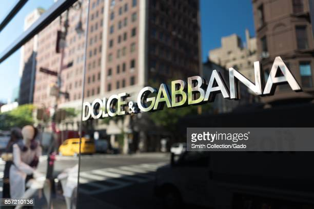 Signage for the Dolce and Gabbana upscale clothing boutique on Madison Avenue on the Upper East Side of Manhattan New York City New York September 15...