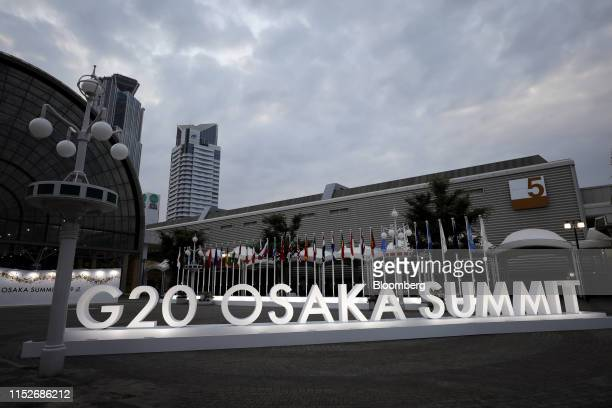 Signage for the Group of 20 summit stands illuminated in Osaka, Japan, on Friday, June 28, 2019. Leaders from some of the worlds wealthiest countries...