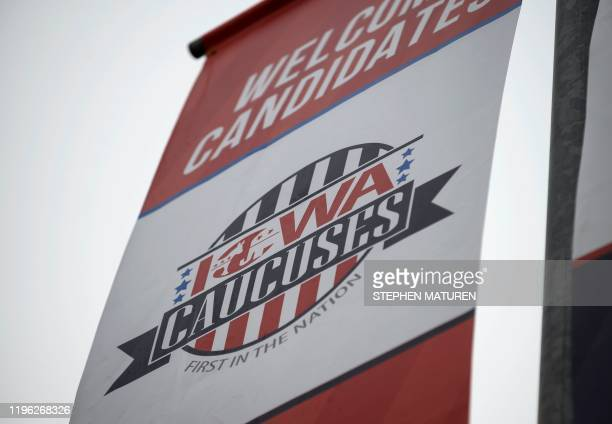 Signage for the Iowa Caucuses hang in downtown Des Moines Iowa on January 25 2020 With nine days to go candidates vying for the Democratic...