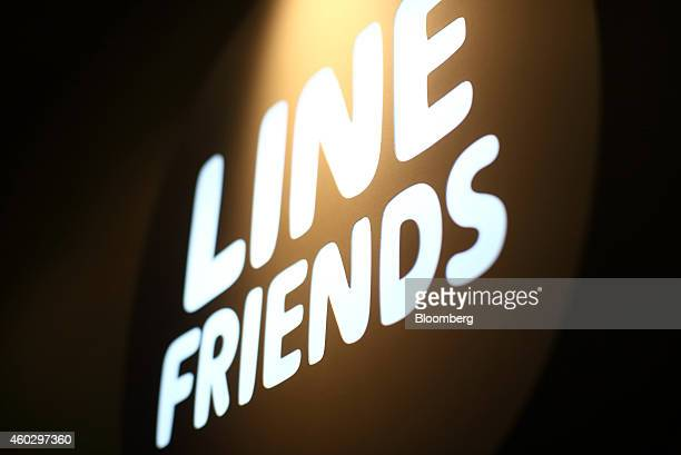 Signage for the Line Friends Store operated by Line Corp is displayed outside the store in Tokyo Japan on Thursday Dec 10 2014 Line which makes money...