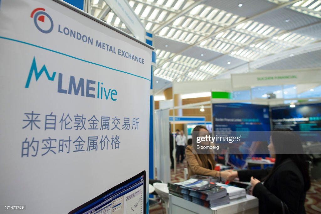 Signage for the London Metal Exchange LMElive, the exchanges real-time price and data system, stands on display during the LME Week Asia 2013 Seminar in Hong Kong, China, on Tuesday, June 25, 2013. Hong Kong Exchanges & Clearing Ltd. mapped out a strategy for expanding its commodities business after buying the London Metal Exchange, seeking greater access to China, introducing products and potentially raising fees. Photographer: Jerome Favre/Bloomberg via Getty Images