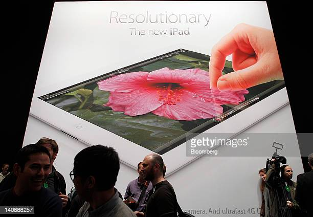 Signage for the new version of Apple Inc's iPad table computer is displayed during an Apple event in San Francisco California US on Wednesday March 7...