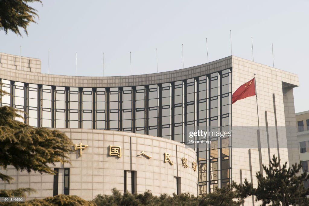 Signage for the People's Bank of China is displayed on its headquarters building in Beijing, China, on Monday, Feb. 26, 2018. China's Communist Party is set to repeal presidential term limits in a move that would allowXi Jinpingto rule beyond 2023, completing the country's departure from a political system based on collective leadership. Photographer: Giulia Marchi/Bloomberg via Getty Images