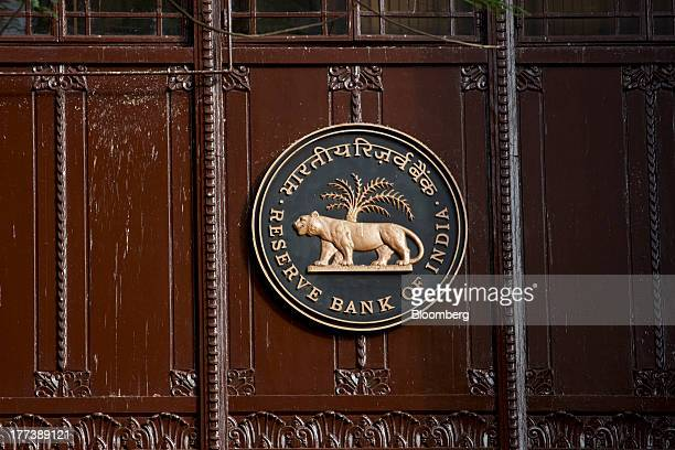Signage for the Reserve Bank of India is displayed at the central bank's headquarters in Mumbai India on Friday Aug 23 2013 Indias rupee plunged 44...
