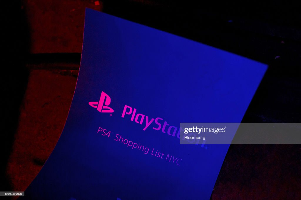 Signage for the Sony PlayStation 4 console is displayed during its midnight launch event in New York, U.S., on Friday, Nov. 15, 2013, 2013. Sony Corp., poised to release the PlayStation 4 game console this week, is confident it can meet analysts' sales estimates of 3 million units by year-end, exploiting an early advantage over Microsoft Corp.'s Xbox One. Photographer: Victor J. Blue/Bloomberg via Getty Images