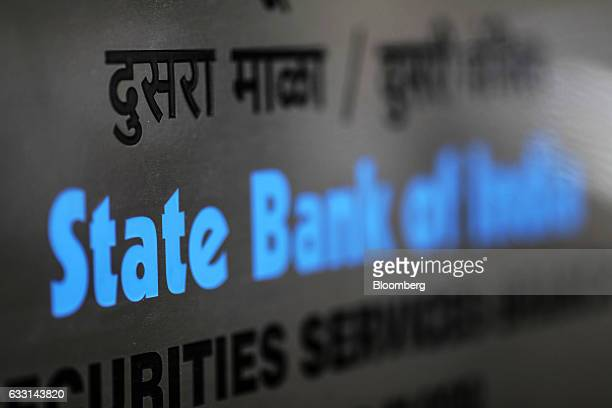 Signage for the State Bank of India Ltd is seen at a branch in Mumbai India on Friday Jan 27 2017 India's Finance Ministry will recommend bold tax...