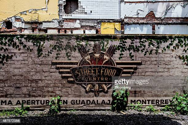 Signage for the Street Food Center is displayed at the entrance to a park in the Roma neighborhood of Mexico City Mexico on Monday Aug 31 2015 The...