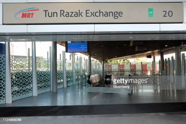 Signage for the Tun Razak Exchange MRT station is displayed near the site of the under construction Exchange TRX precinct in Kuala Lumpur Malaysia on...
