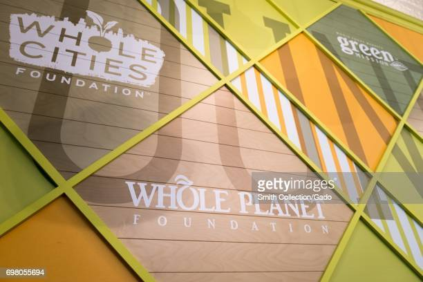 Signage for the Whole Planet Foundation, Whole Cities Foundation, and other charitable foundations at the Whole Foods Market grocery store in Dublin,...